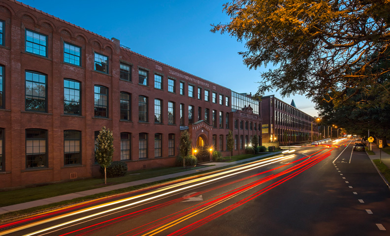 exterior image of brick office building in the evening